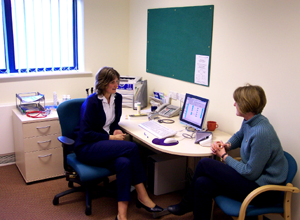 Photograph of a doctor with patient in a consulting room